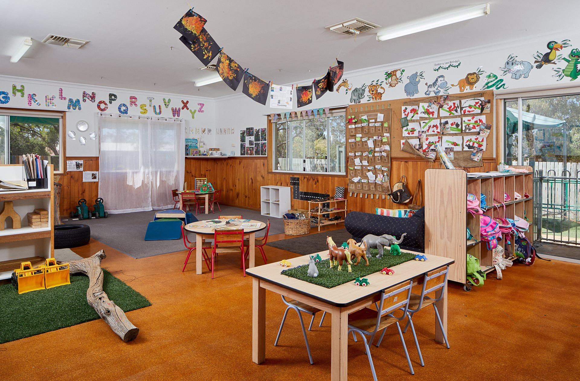 Child care centre room with farm animals set up on table